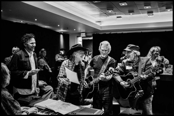 Mickey Raphael with Willie Nelson, Kris Kristofferson, and Merle Haggard. Photograph by Danny Clinch