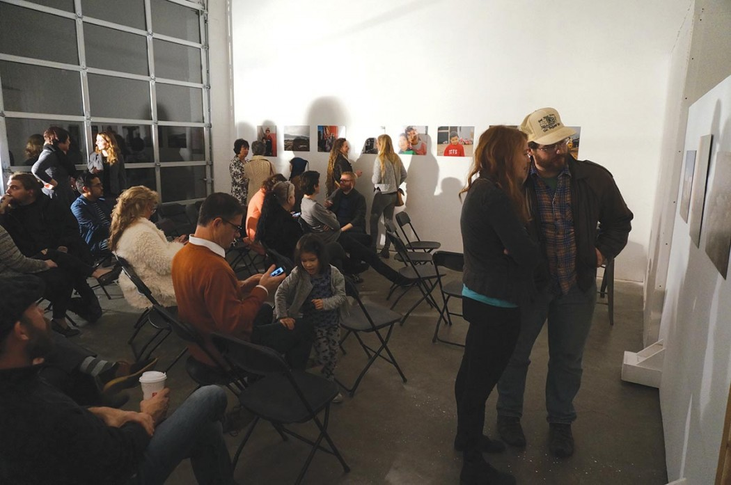 Crowd at artist reception and talk at The Red Arrow Gallery