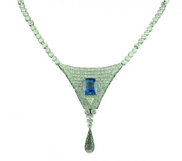 Blue sapphire (6.01 carats) with diamonds
