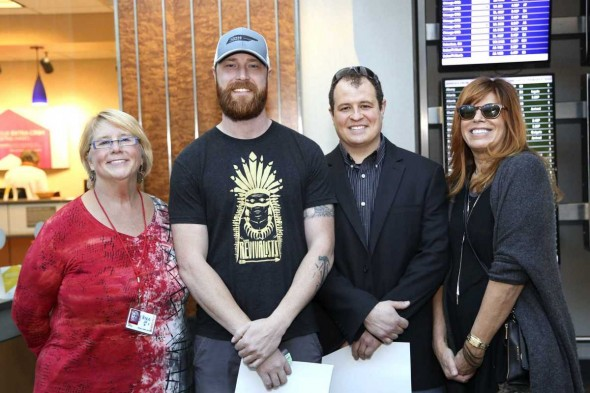 From left to right is Mary Grissim, curator for Arts at the Airport; Jake Elliot, winning artist; Brian Somerville, winning artist; and Nina Miller, executive director of Bonnaroo Work Fund.