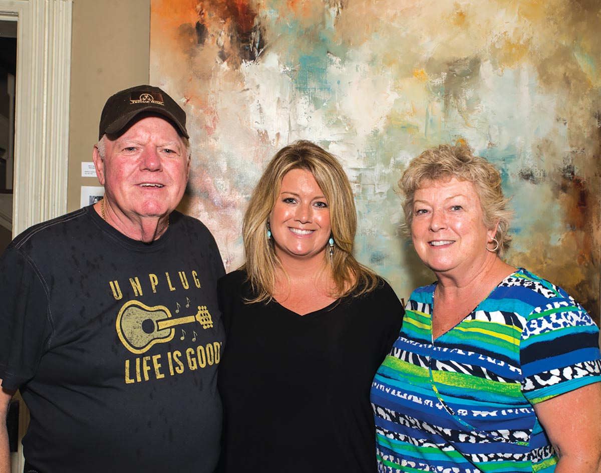 Ron Hughes, Julie A. Harvey and Pat Hughes at Gallery 202. Photograph by Tiffani Bing