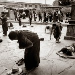 Prostrations by pilgrims outside of Jokhang Temple in Lhasa, Tibet. This was my first trip to this part of the world visiting sacred and holy sights. I was in awe of the scene before me.