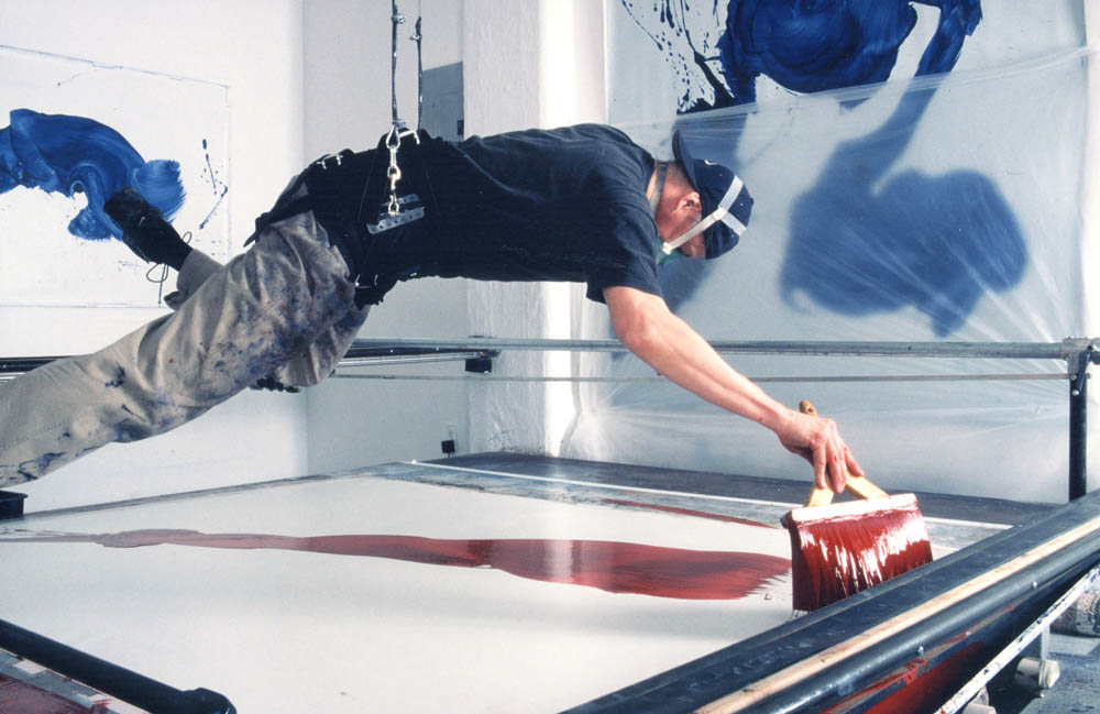 Artist James Nares hangs suspended, creating a single-brushstroke painting.