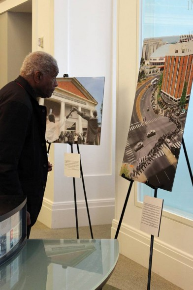 Artist Richard Hunt examines Tennessean photographer Larry McCormack's photo merge series at the Nashville Public Library's Civil Rights Room