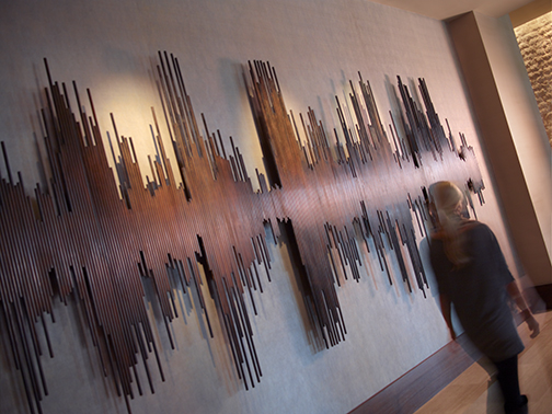 "Matt Devine, 387 5/8ths Steel Rods, Steel with patina, 84"" x 252"" x 4"". Courtesy of Omni Hotels & Resorts"