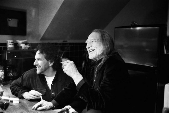 Mickey Raphael with Willie Nelson. Photograph by Danny Clinch