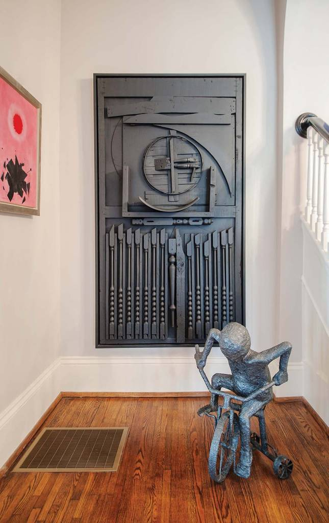 Foyer: Louise Nevelson, Painted black wood sculpture; Foyer: Jim Gibson, Boy on Tricycle, Sculpted steel