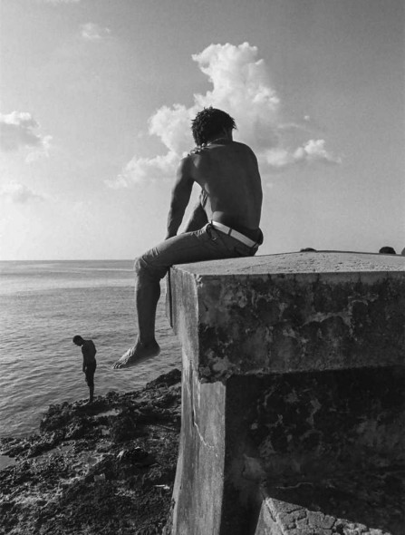 Julia W. Gary, Adonis of the Sea: During a photography trip to Havana, Cuba I spent an afternoon walking along the Malecon (carrying my FE2 Nikon and rolls of black and white film) watching and photographing the locals as they interacted with each other. I happened upon this muscular young man sitting on the wall and noticed how the sun outlined his body and played on his skin, emphasizing the beauty and hope of the Cuban people.