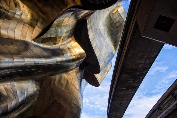 Katherine Seghers: While on my honeymoon in Seattle, we spent a lot of time at EMP. I looked up from the sidewalk and was captivated by Frank Gehry's design especially the curves of this part of the building and the juxtaposition with the monorail track.