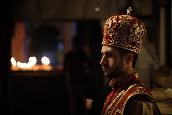 Garrett Mills: This photo was taken in the Church of the Holy Sepulchre in Jerusalem. An Armenian priest participates in a service.