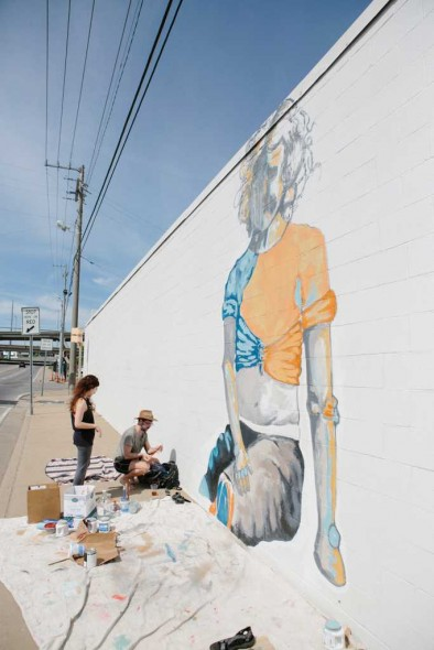 Tinsely Dempsey helps Seth Prestwood with the first panel of the mural. Photograph by Blu Sanders