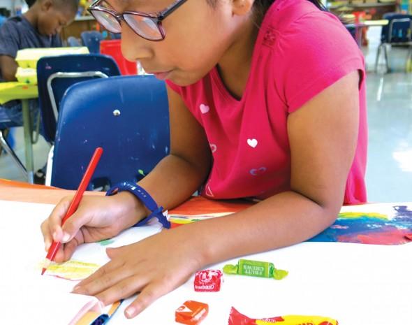 Deyanira works on her candy contour drawing
