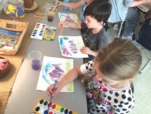 Kindergarteners watercolor ocean habitats; Photography by Brandi Self