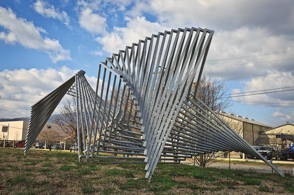 Linda Howard, Star Center, 1993, Brushed aluminum, 8.5' x 24' x 12'
