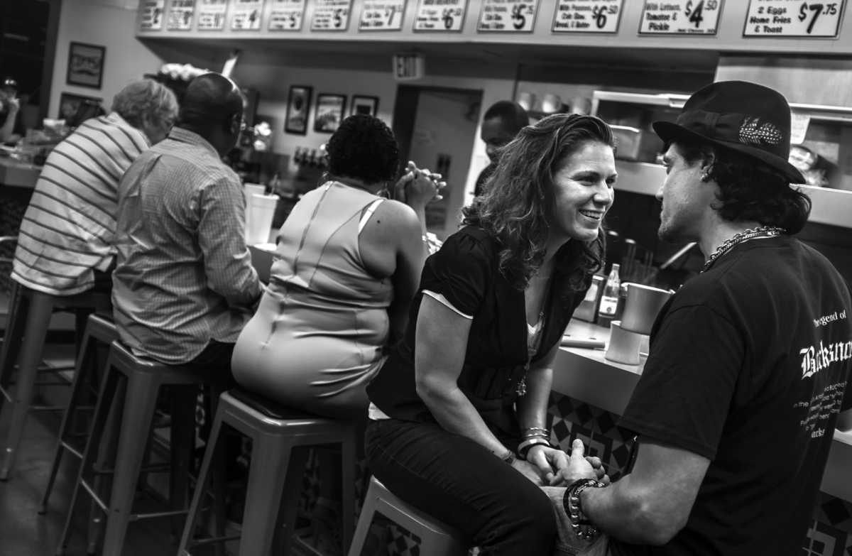 At 3:00 a.m. Elizabeth Stamps talks with her boy friend Jace Aaron at the Hermitage Cafe.