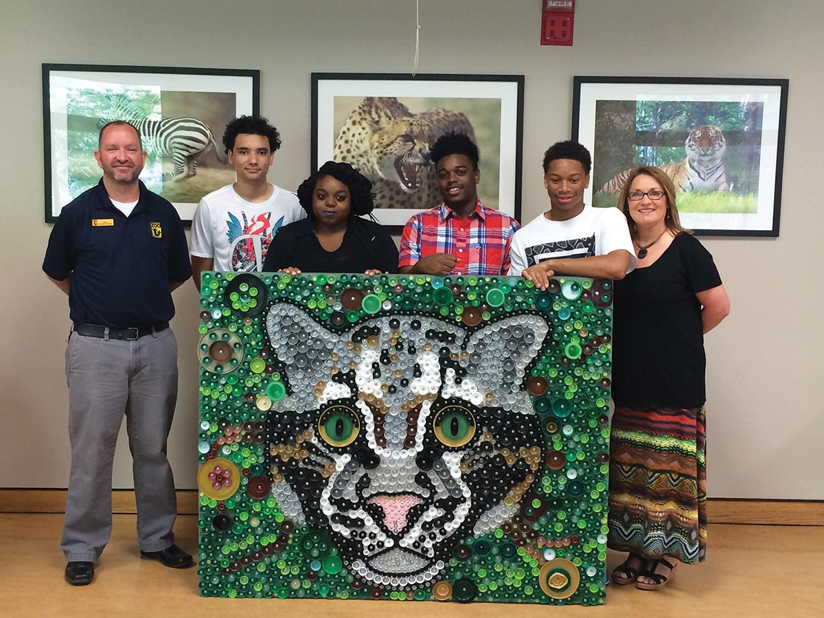 Students from Cohn High School created a mural made of bottle caps that was given to the Nashville Zoo for their 20th anniversary. Photograph by Lori Kissinger